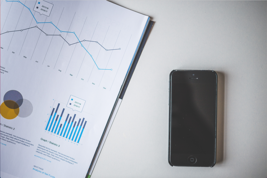 A stock photo showing statistics and an iphone